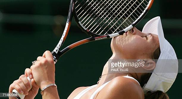 Severine Bremond of France kisses her racket after defeating Ai Sugiyama of Japan on the 4th round of the Wimbledon Tennis Championships in Wimbledon...