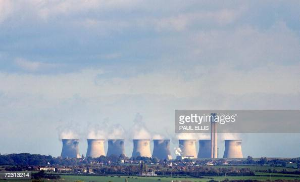 Steam rises from the eight cooling towers at the Ferrybridge power station near Leeds in the north of England 30 October 2006 The coal fired power...