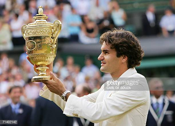 Switzerland's Roger Federer celebrates his fourth consecutive Wimbledon Championships title after beating Spain's Rafael Nadal at the Wimbledon...