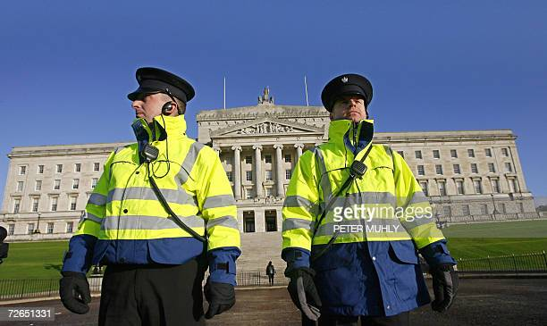 Two security guards stand outside the Stormont Parliament building in Belfast in Northern Ireland 27 November 2006 Northern Ireland's main parties...