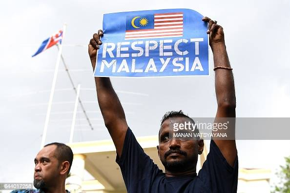 A United Malays National Organization Youth activists poses with a placard during a protest outside the North Korean Embassy in Kuala Lumpur on...