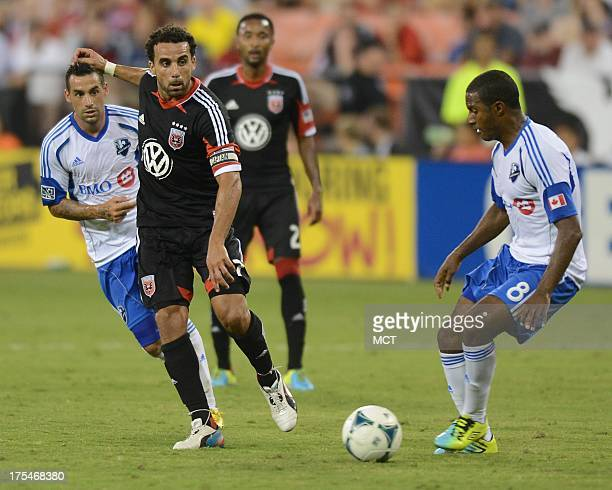 DC United midfielder Dwayne De Rosario lays off a pass around Montreal Impact midfielder Patrice Bernier during the second half at RFK Stadium in...