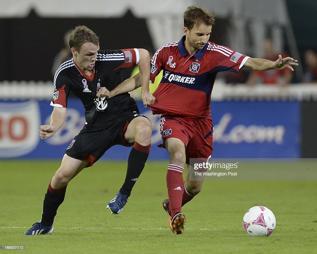 C United midfielder Jared Jeffrey and Chicago Fire forward Mike Magee pull on each other's jerseys during the second half of the game between the DC...