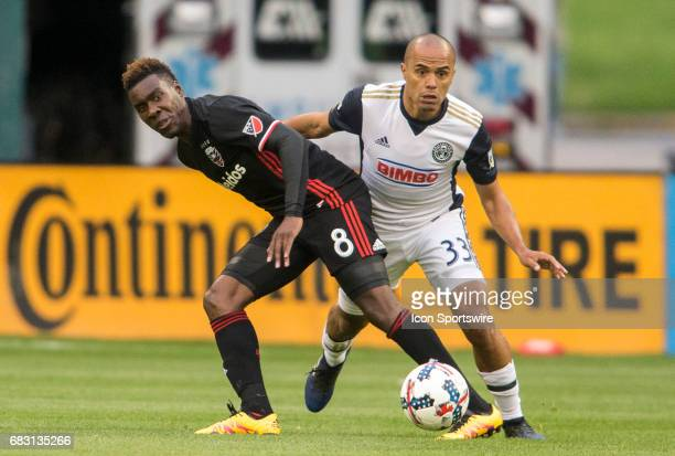 C United midfielder Lloyd Sam and Philadelphia Union defender Fabinho challenge for a loose ball during a MLS match between DC United and the...