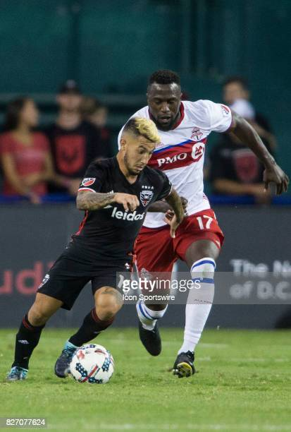 C United midfielder Luciano Acosta moves away from Toronto FC forward Jozy Altidore during a MLS match between DC United and Toronto FC on August 05...