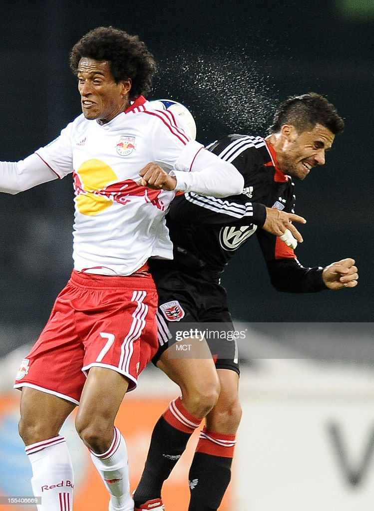 D.C. United midfielder Marcelo Saragosa (11), right, and New York Red Bulls defender Roy Miller (7) battle for a head ball during second-half action in an MLS Eastern Conference semifinal at RFK Stadium in Washington, D.C., Saturday, November 3, 2012. United and the Red Bulls tied 1-10.