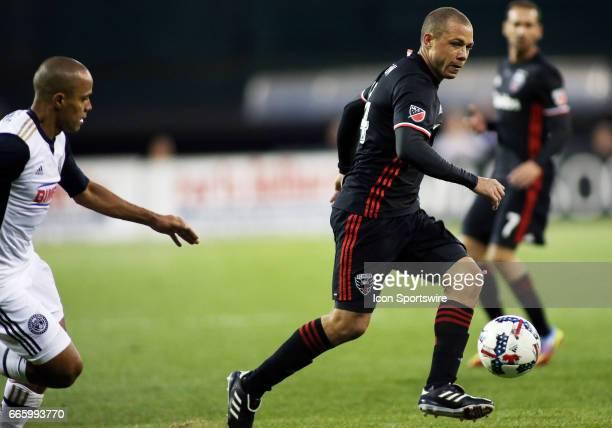 C United midfielder Nick DeLeon races past Philadelphia Union defender Fabinho during a match between DC United and Philadelphia Union at RFK...