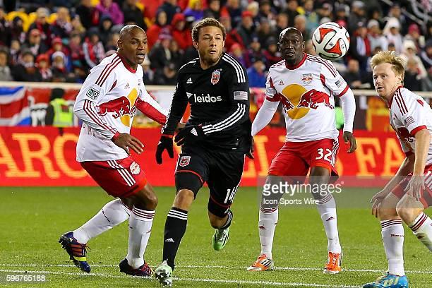 C United midfielder Nick DeLeon splits the defenders New York Red Bulls defender Ibrahim Sekagya and New York Red Bulls defender Jamison Olave during...