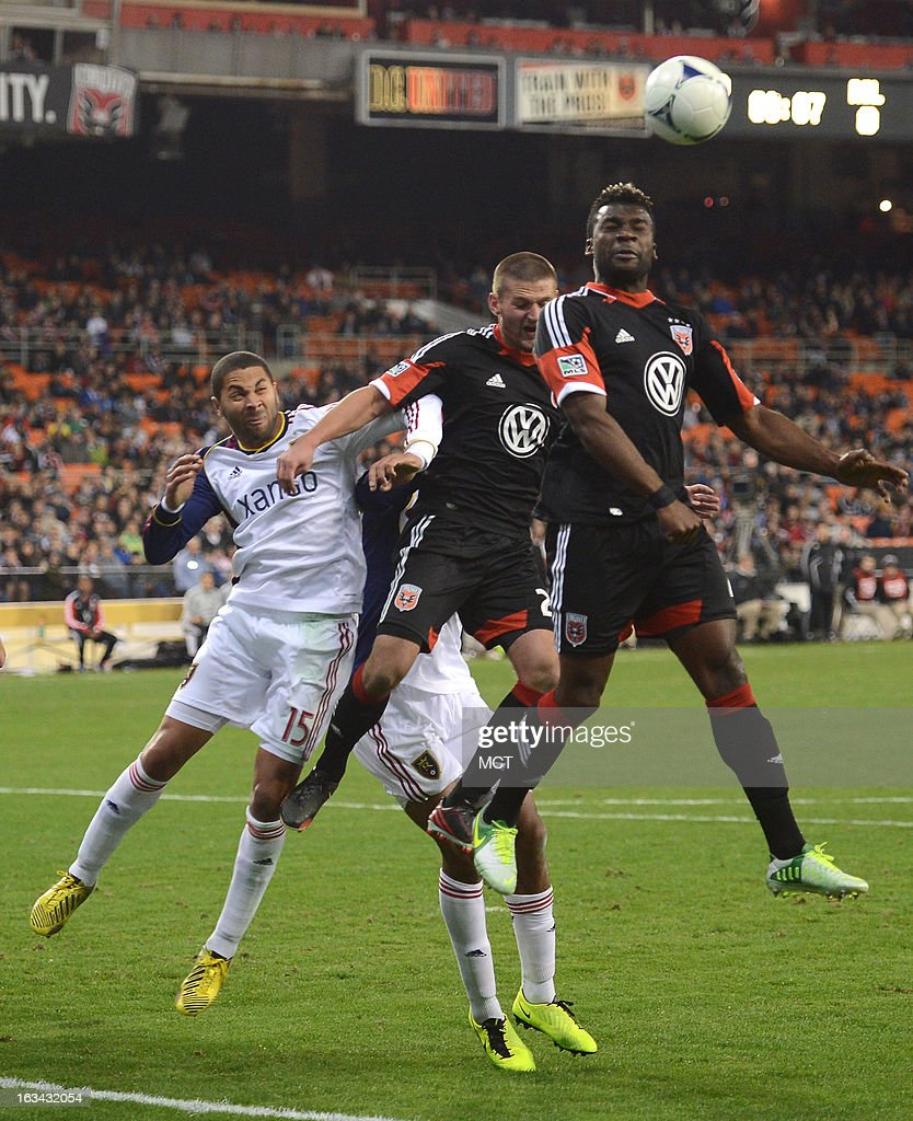 D.C. United midfielder Perry Kitchen (23), center, D.C. United defender/midfielder Brandon McDonald (4), right, Real Salt Lake forward Alvaro Saboru (15) and Real Salt Lake defender Chris Schuler (28), back, battle for a D.C. United corner kick in the second half at RFK Stadium in Washington, D.C., Saturday, March 9, 2013. United defeated RSL, 1-0.