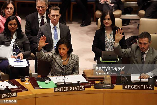 S United Nations Ambassador Susan Rice votes at a UN Security Council meeting on imposing a fourth round of sanctions against North Korea in an...