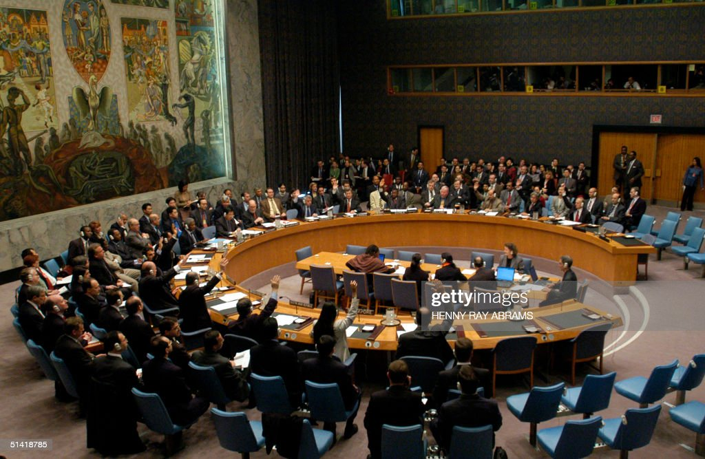 United Nations ambassadors vote in the Security Council for the USbacked resolution calling for weapons inspections in Iraq 08 November at UN...