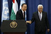 United Nations chief Ban Kimoon and Palestinian president Mahmud Abbas pose for a picture during a press conference following a meeting at the...