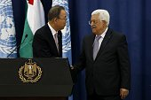 United Nations chief Ban Kimoon shakes hands with Palestinian president Mahmud Abbas during a press conference following a meeting at the Muqataa...