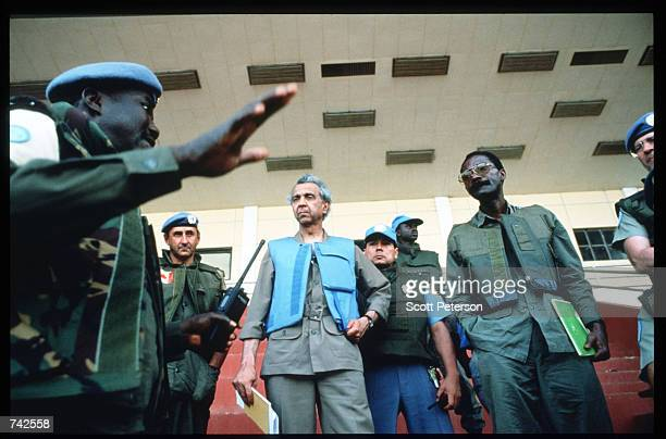 United Nations Chief of Staff Iqbal Riza talks with other UN peacekepers May 25 1994 in Kigali Rwanda Following the assassination of President...