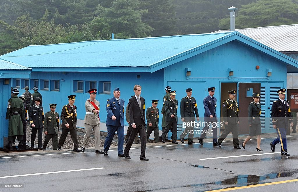 United Nations Command officials walk away after a repatriation ceremony for the body of a North Korean soldier, who was found dead in the Han river near the border in July, during a repatriation ceremony at the truce village of Panmunjom in the Demilitarized zone dividing the two Koreas on September 11, 2013. The ceremony was supervised by United Nations officials who have been monitoring the truce since the 1950-53 Korean War.