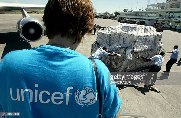 A United Nations employee watches the unloading of UN medical supplies at the international airport 03 March 2004 in PortauPrince airport A planeload...