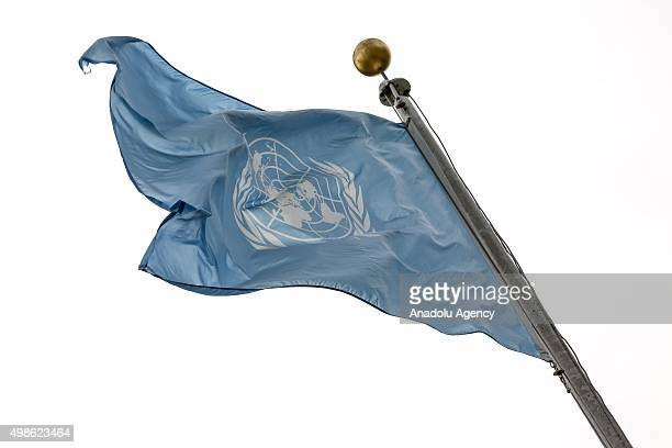 United Nations flag is seen in front of the United Nations Headquarters in New York United States on November 24 2015