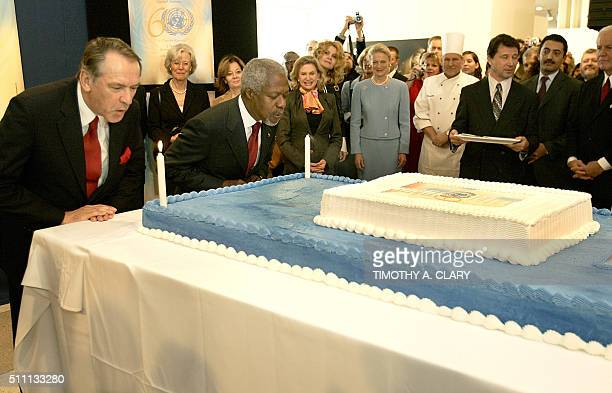United Nations General Assembly President Jan Eliasson and UN Secretary General Kofi Annan blow out the candles on a birthday cake at the United...