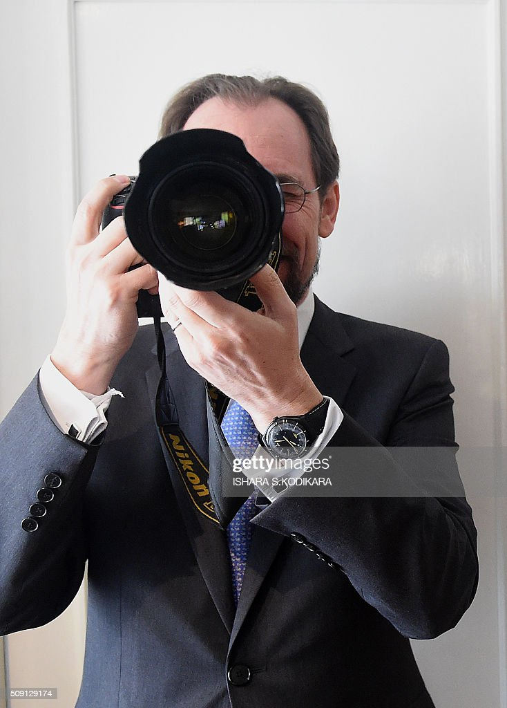 United Nations High Commissioner for Human Rights Zeid Ra'ad Al Hussein checks out AFP photographer Ishara Kodikaras camera with its 70-200mm lens ahead of a meeting with Sri Lankas main opposition leader R. Sampanthan in Colombo on February 9, 2016. Zeid is wrapping up a four-day visit to Sri Lanka to gauge the island's progress in investigating wartime atrocities. AFP PHOTO/ Ishara S. KODIKARA / AFP / Ishara S.KODIKARA