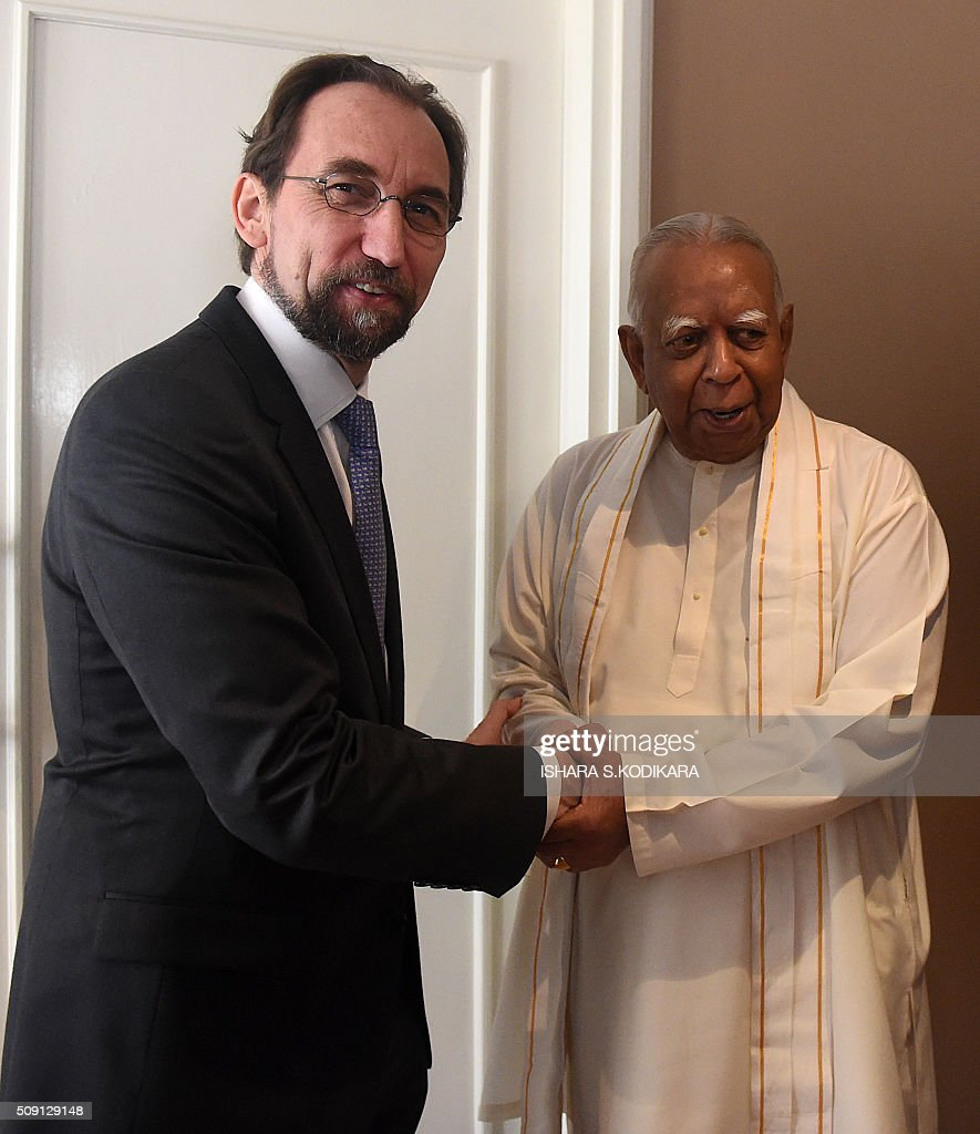 United Nations High Commissioner for Human Rights Zeid Ra'ad Al Hussein (L) shakes hands with Sri Lankas main opposition leader R. Sampanthan in Colombo on February 9, 2016. Zeid is wrapping up a four-day visit to Sri Lanka to gauge the island's progress in investigating wartime atrocities. AFP PHOTO/ Ishara S. KODIKARA / AFP / Ishara S.KODIKARA