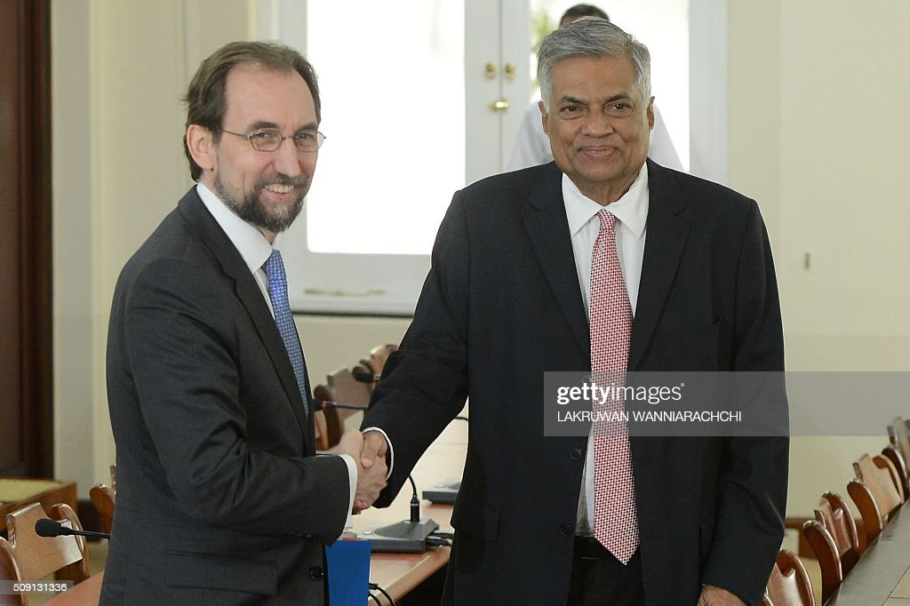 United Nations High Commissioner for Human Rights Zeid Ra'ad Al Hussein (L) shakes hands with Sri Lankas Prime Minister Ranil Wickremesinghe (R) ahead of a meeting in Colombo on February 9, 2016. Zeid began his first visit to Sri Lanka to gauge the island's progress in investigating allegations troops committed atrocities during a prolonged civil war. AFP PHOTO / LAKRUWAN WANNIARACHCHI / AFP / LAKRUWAN WANNIARACHCHI
