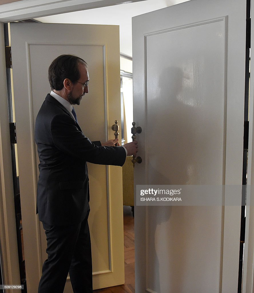 United Nations High Commissioner for Human Rights Zeid Ra'ad Al Hussein closes the doors before meeting with Sri Lankas main opposition leader R. Sampanthan in Colombo on February 9, 2016. Zeid is wrapping up a four-day visit to Sri Lanka to gauge the island's progress in investigating wartime atrocities.. AFP PHOTO/ Ishara S. KODIKARA / AFP / Ishara S.KODIKARA