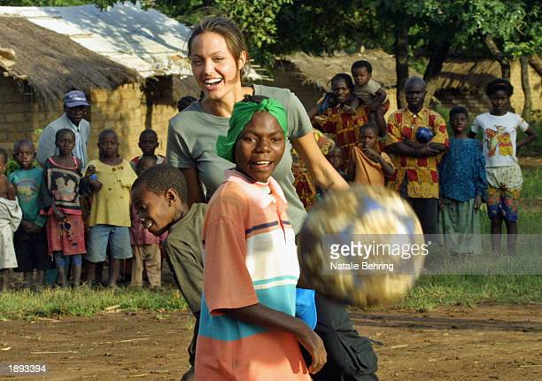 United Nations High Commissioner for Refugees Goodwill Ambassador Angelina Jolie helps to build a hut for newly arrived unaccompanied minors on March...
