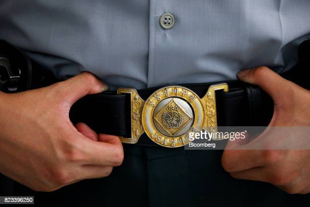 A United Nations Joint Security Area badge is displayed on the belt of a South Korean soldier standing guard at the truce village of Panmunjom in the...