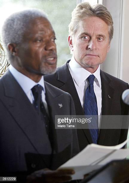 United Nations 'Messenger of Peace' actor Michael Douglas looks on as UN SecretaryGeneral Kofi Annan delivers a speech at UN headquarters in...