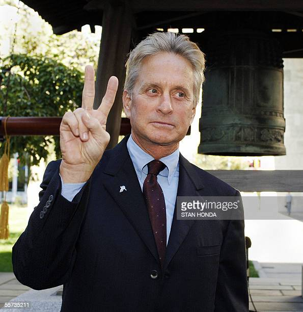 United Nations Messenger of Peace Michael Douglas makes a peace sign 21 September as he stands in front of the Peace Bell for a commemoration of the...