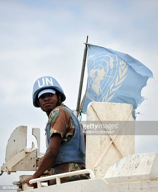 This file picture dated on November 13 2008 shows an United Nations peacekeeper from South Africa riding atop of an armored vehicle in the North Kivu...