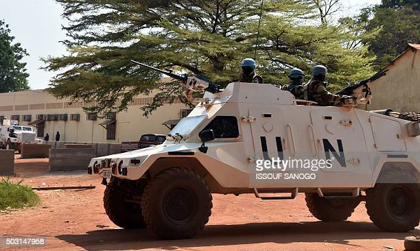 United Nations peacekeepers patrol outside a votecounting centre for the presidential and parliamentary elections on January 2 2016 in Bangui UN...