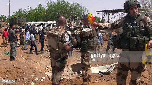 United Nations peacekeepers soldiers stand in front of Chinese UN peacekeeping forces camp on June 1 2016 in Gao after AlQaeda's North African...