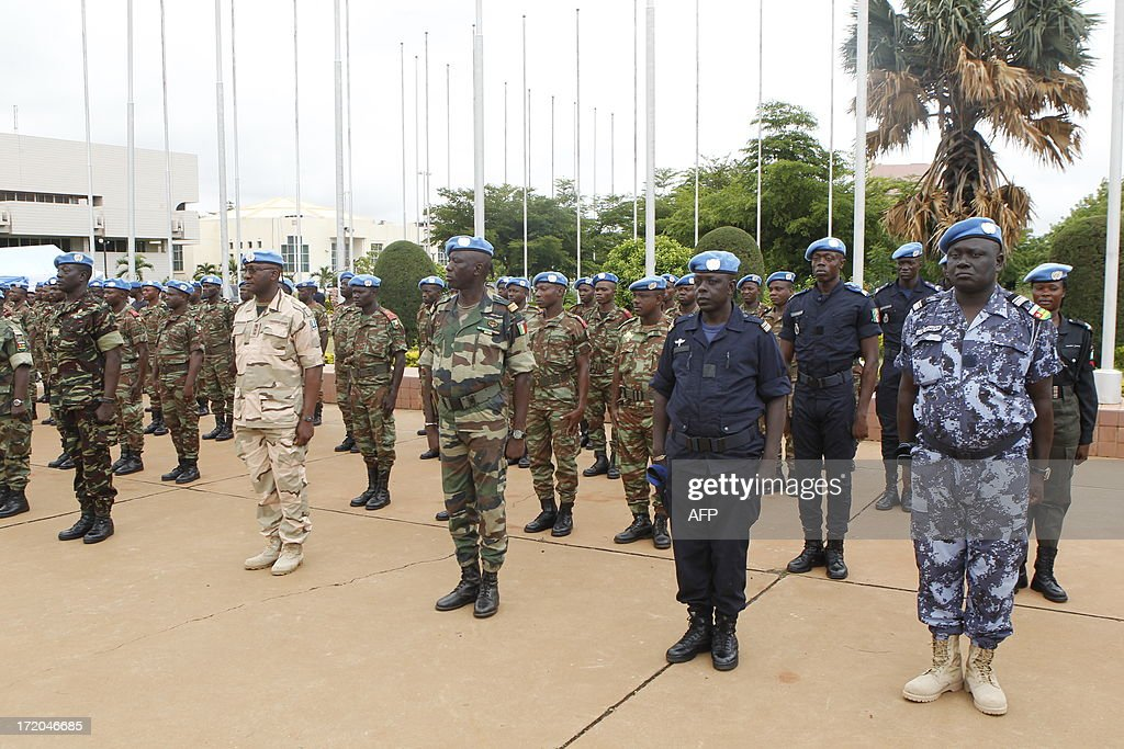 United Nations peacekeepers stand at attention on July 1, 2013 during a transfer of duties ceremony from African troops in Mali in Bamako. The UN's mission is to ensure stability in the conflict-scarred nation just four weeks ahead of planned elections. A 12,600-strong force officially replaced the AFISMA military mission, which has been supporting French soldiers who entered Mali in January to halt an Islamist advance and help the government re-establish its authority over the vast country.