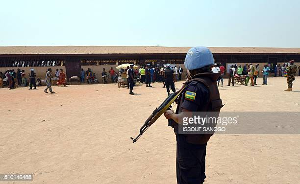 A United Nations peacekeepers stands guard outside a polling station in Bangui as people go to the polls to take part in the Central African Republic...