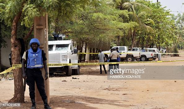 United Nations peacekeeping solders stand by a cordon set up at the site where a gunman opened fire at a UN residence in Bamako on May 20 2015 An...