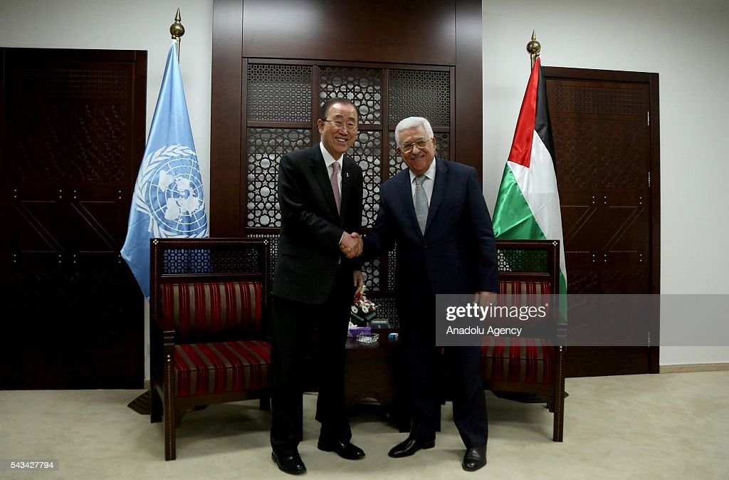United Nations Secretary General Ban Ki-moon (L) and Palestinian President Mahmoud Abbas (R) shake hands as they meet at Presidential Office in Ramallah, West Bank on June 28, 2016.
