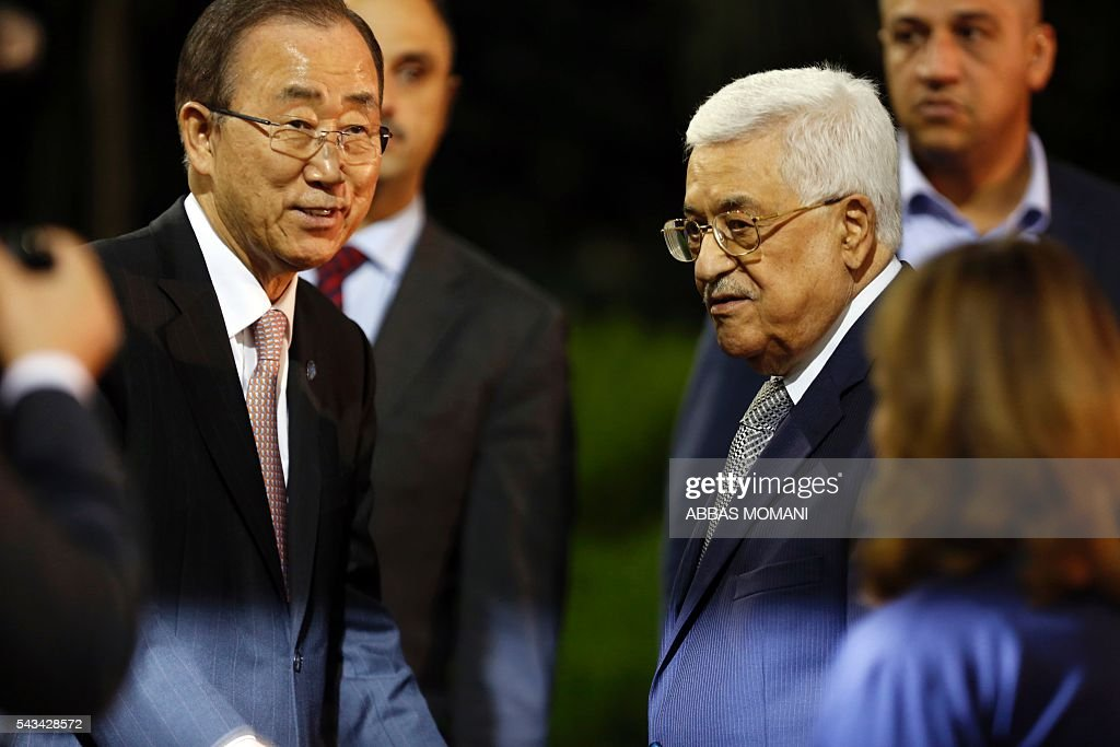 United Nations Secretary General Ban Ki-moon and Palestinian president Mahmud Abbas pose for photographers during a joint press conference after a meeting on June 28, 2016 in the West Bank city of Ramallah. Ban urged Israeli Prime Minister Benjamin Netanyahu to take 'courageous steps' toward peace as he visited Israel and the Palestinian territories. MOMANI