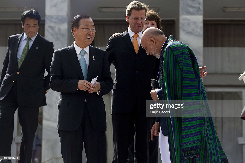 United Nations Secretary General Ban Ki-moon, German Foreign Minister, Guido Westerwelle, European Union Foreign Minister, Catherine Ashton (partially concealed) and Afghan President Hamid Karzai laugh as they walk to take part in the group photograph at the conclusion of the International Conference on Afghanistan at the Foreign Affairs Ministry in Kabul on July 20, 2010 in Kabul, Afghanistan. During the international one-day conference attended by representatives from 70 countries, the international community expressed its support for the Afghan national security forces to lead and conduct military operations in all provinces by the end of 2014.