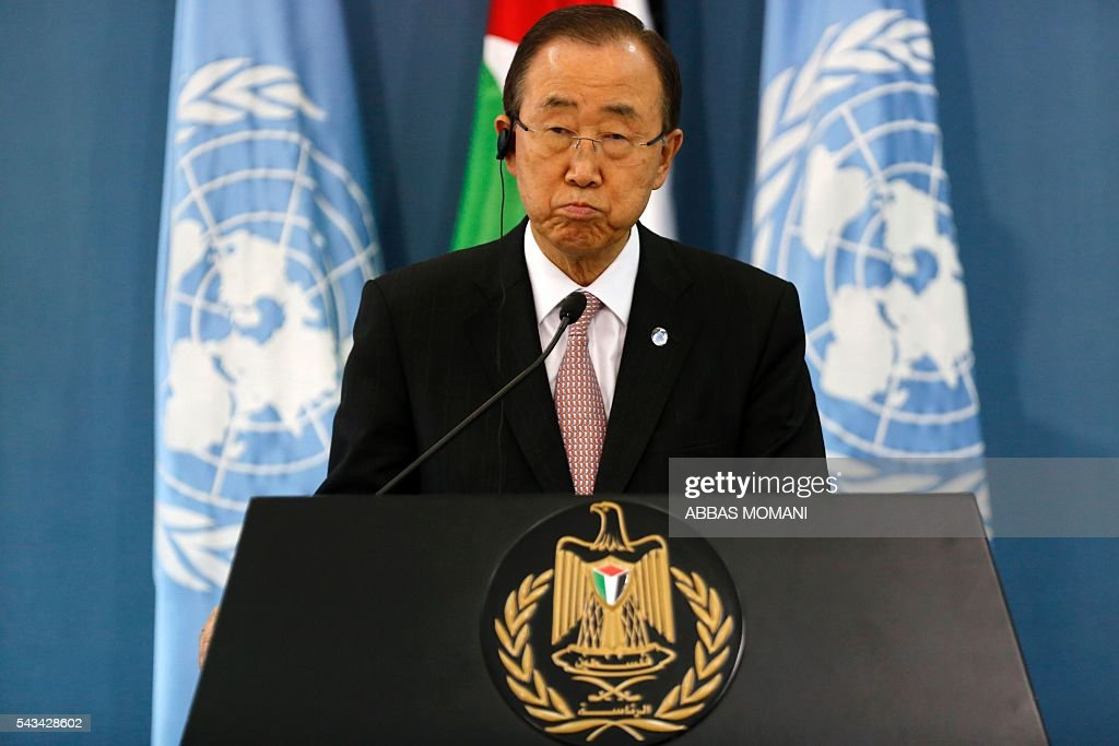 United Nations Secretary General Ban Ki-moon listens during a joint press conference with Palestinian president after a meeting on June 28, 2016 in the West Bank city of Ramallah. Ban urged Israeli Prime Minister Benjamin Netanyahu to take 'courageous steps' toward peace as he visited Israel and the Palestinian territories. MOMANI