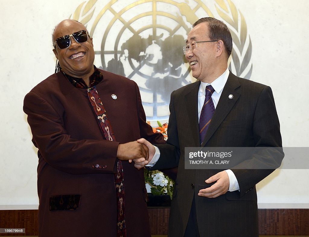 United Nations Secretary General Ban Ki-moon meets Grammy Award-winning songwriter and musician and UN Messenger of Peace Stevie Wonder at the United Nations in New York on January 16, 2013.