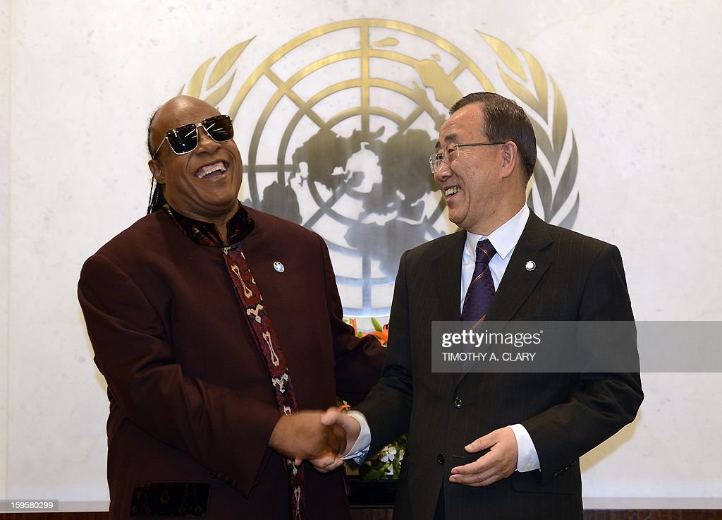 United Nations Secretary General Ban Ki-moon meets Grammy Award-winning songwriter and musician Stevie Wonder and UN Messenger of Peace at the United Nations in New York on January 16, 2013. AFP PHOTO / TIMOTHY A. CLARY