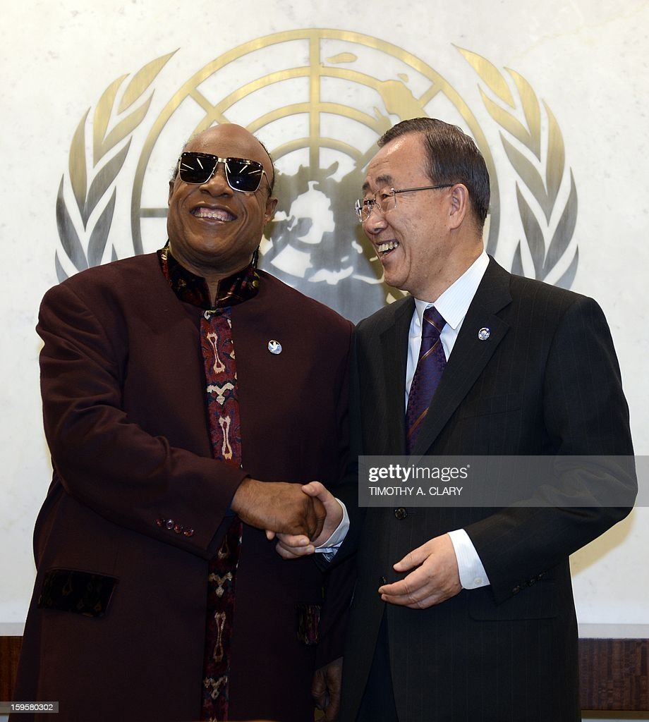 United Nations Secretary General Ban Ki-moon meets Grammy Award-winning songwriter and musician Stevie Wonder and UN Messenger of Peace at the United Nations in New York on January 16, 2013.
