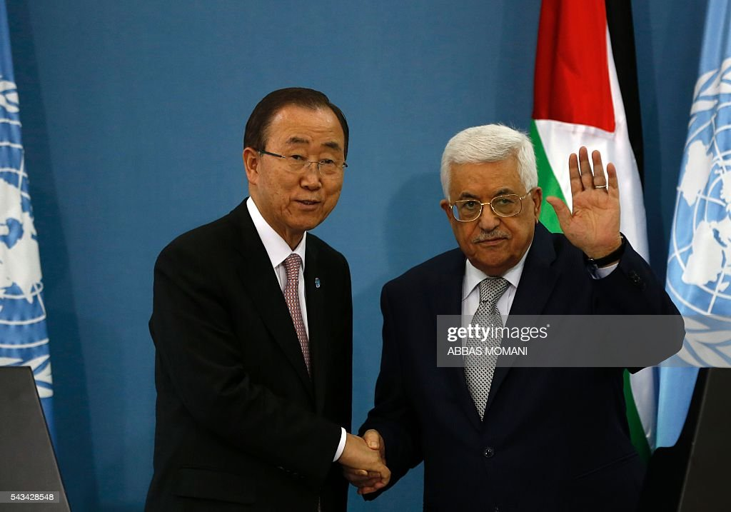 United Nations Secretary General Ban Ki-moon (L) shakes hands with Palestinian president Mahmud Abbas during a joint press conference after a meeting on June 28, 2016 in the West Bank city of Ramallah. Ban urged Israeli Prime Minister Benjamin Netanyahu to take 'courageous steps' toward peace as he visited Israel and the Palestinian territories. MOMANI