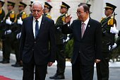 United Nations Secretary General Ban Kimoon walks alongside Palestinian foreign minister Riyad alMalki as he arrives at the Muqataa the Palestinian...