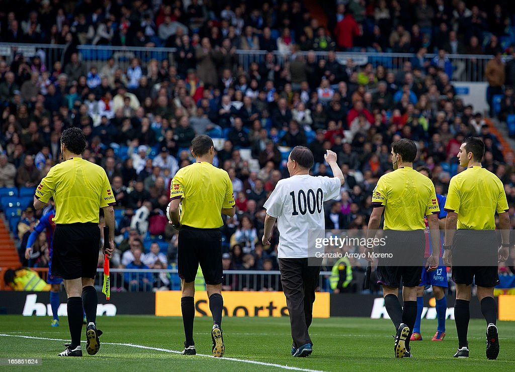 United Nations Secretary-General Ban Ki Moon waves before taking the honorary kick-off before the La Liga match between Real Madrid CF and Levante UD at Santiago Bernabeu Stadium on April 6, 2013 in Madrid, Spain.