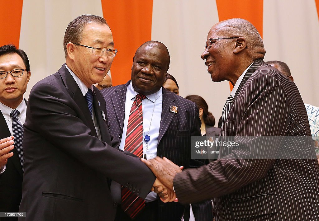 United Nations Secretary-General Ban Ki-moon (L) and Nelson Mandela's close friend Andrew Mlangeni (R) shake hands before the start of an informal meeting of the plenary of the General Assembly, on the commemoration of the Nelson Mandela International Day, at U.N. headquarters on July 18, 2013 in New York City. South Africa's first black president and anti-apartheid leader turns 95 today on his 41st day in the hospital.