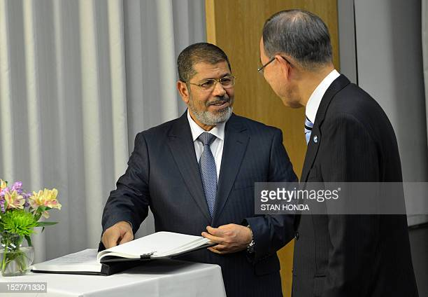 United Nations SecretaryGeneral Ban Kimoon has his guest book signed by Mohamed Morsy President of Egypt during the 67th United Nations General...