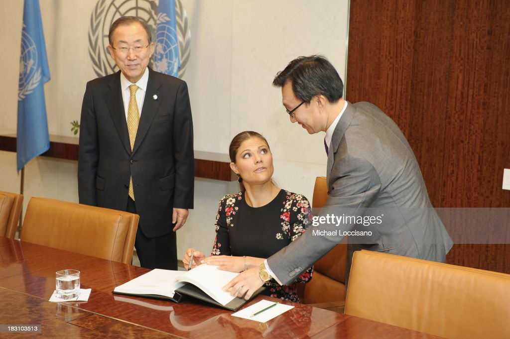 United Nations Secretary-General Ban Ki-moon looks on as Crown Princess Victoria of Sweden signs the UN guest book handed to her by UN Chief of Protocol Yeocheol Yoon during her visit to The United Nations at the United Nations on October 4, 2013 in New York City.