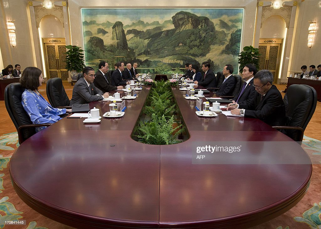 United Nations Secretary-General Ban Ki-moon (4th L) meets with Chinese president Xi Jinping (4th R) during a meeting at the Great Hall of the People in Beijing on June 19, 2013. United Nations Secretary-General Ban Ki-moon met Chinese president Xi Jinping for talks on June 19, with North Korea and Syria expected to dominate discussions.